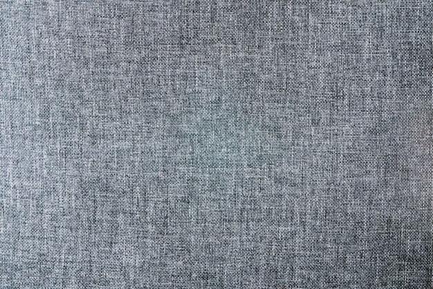 Tissus synthétiques de couleur noire, texture de tissu de polyester fond se bouchent