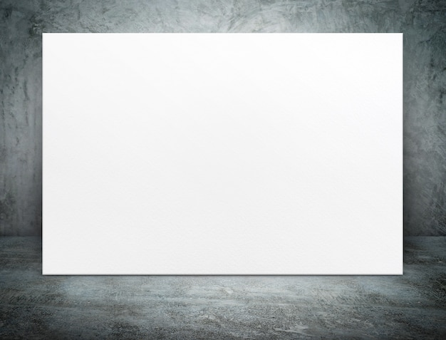 Toile d'affiche papier blanc vierge au béton salle grunge
