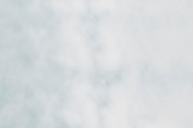 Toile de fond texturée en pierre marbrée blanche