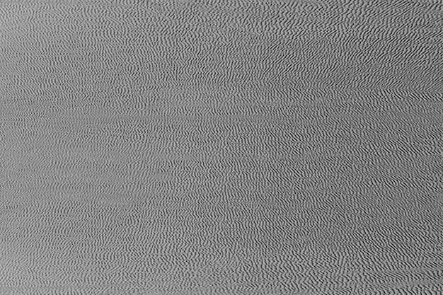 Toile de fond en tissu gris texturé grain