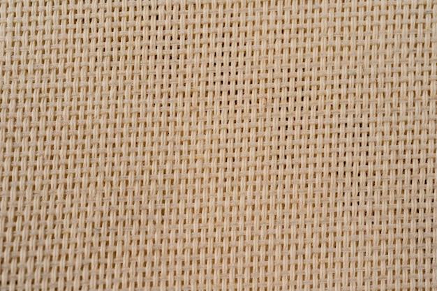 Toile de jute toile de jute tissé texture background. fond de tissu en coton avec des taches