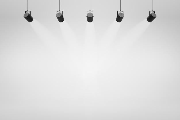 Toiles de fond de studio blanc vides et projecteurs sur fond de salle de divertissement avec scène montrant.