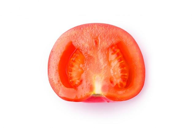 Une tomate rouge fraîche isolée sur blanc