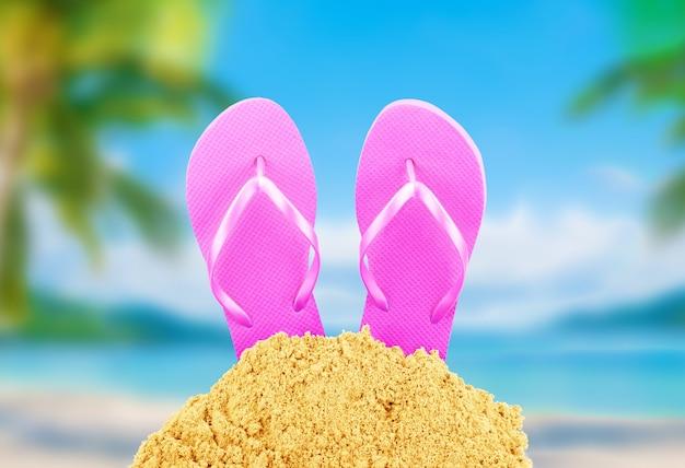 Des tongs dans le sable contre la plage