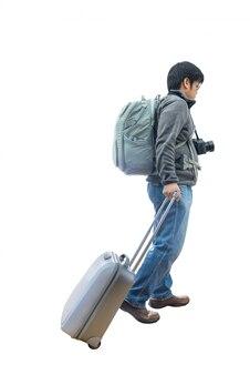 Toute la longueur du jeune voyageur avec valise et appareil photo