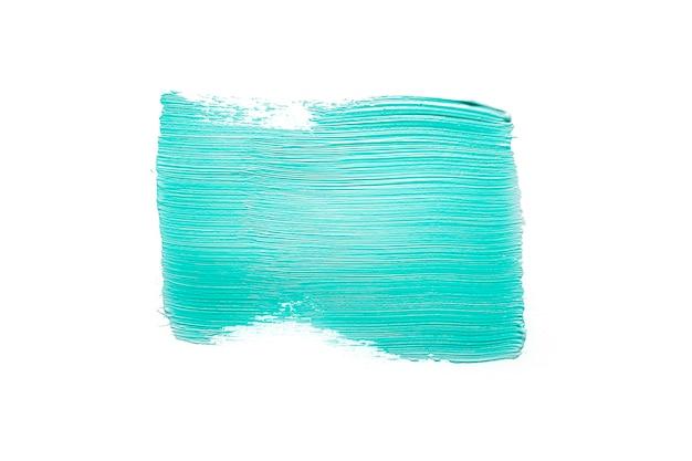 Trace de peinture bleue brillante sur blanc