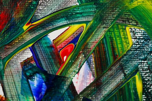 Des traits de couleurs vives peignent sur toile naturelle