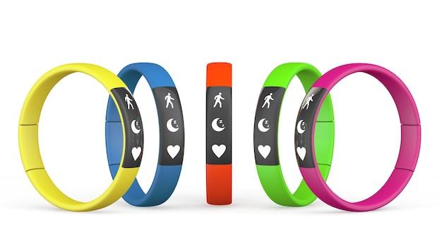 Traqueurs de fitness multicolores sur fond blanc