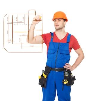 Travailleur dessinant la portée du plan