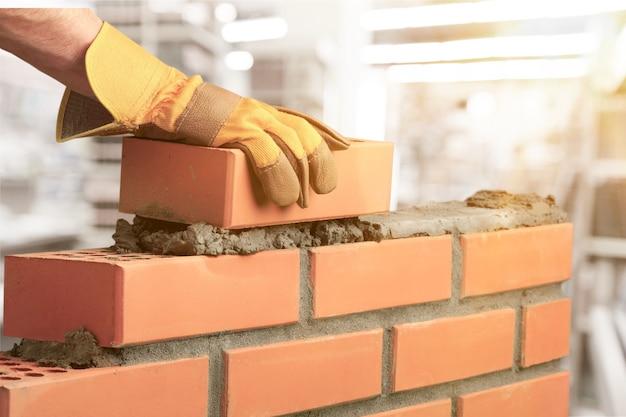 Travailleur de maison de couche de construction de maçonnerie de ciment de maçon