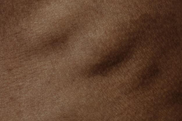 Travers de porc. texture détaillée de la peau humaine. gros coup de jeune corps masculin afro-américain. concept de soins de la peau, soins du corps, soins de santé, hygiène et médecine. il a l'air beau et bien entretenu. dermatologie.