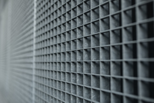 Treillis métallique avec fond de grille à petites cellules avec faible profondeur de champ et mise au point sélective