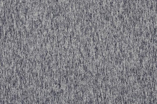 Tricot véritable chiné en fibres synthétiques avec fond texturé
