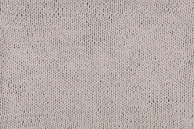 Tricoté en tricot. texture de tissu tricoté gris