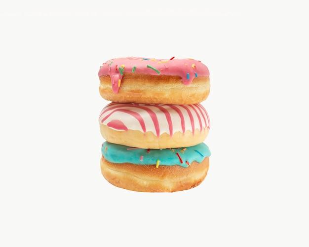 Trois beignets en glaçure avec des pépites de couleur sur un fond blanc