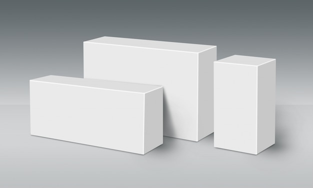 Trois boîtes blanches 3d au sol