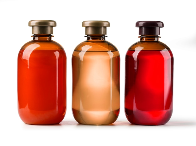 Trois bouteilles cosmétiques