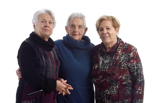 Trois femmes âgées sur blanc