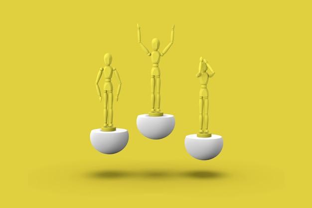Trois jouet homme de couleur jaune sur piédestaux