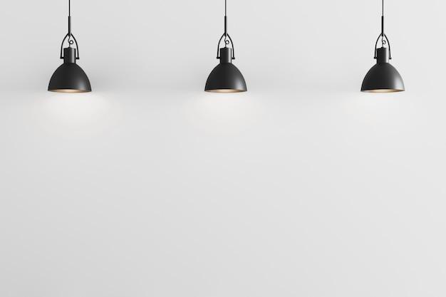 Trois suspensions noires sur fond de mur blanc, plafonniers, mur blanc avec suspensions