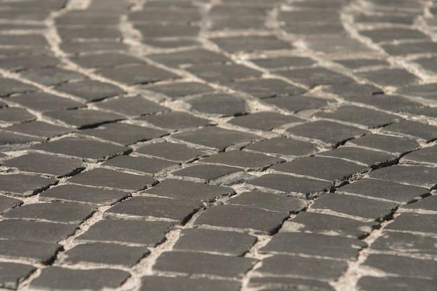 Trottoir dans la vieille ville de pavé noir. texture de fond