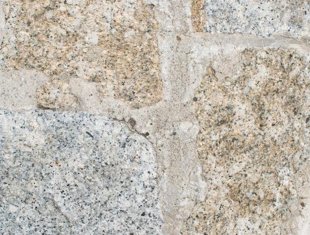 Trottoir en pierre ancienne grise close up
