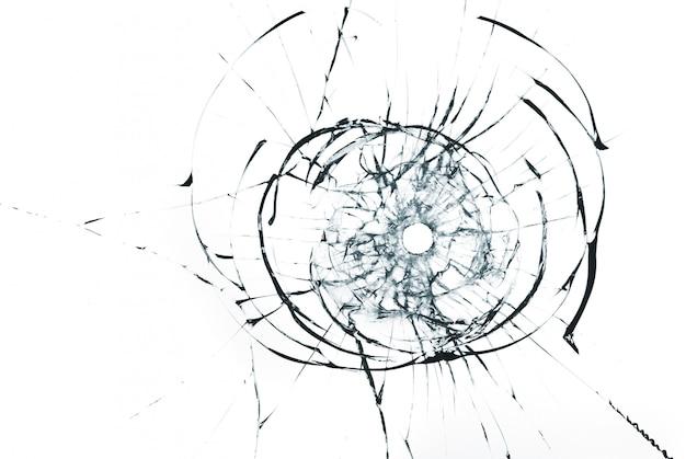 Trou de balle dans le verre se bouchent sur fond blanc