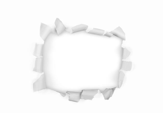 Trou dans le papier sur fond blanc avec chemin de détourage. papier déchiré,