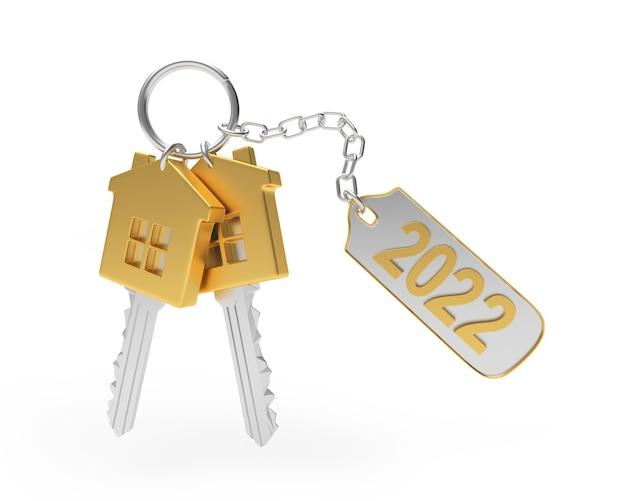 Un trousseau de clés de maison en or et un porte-clés avec le numéro du nouvel an
