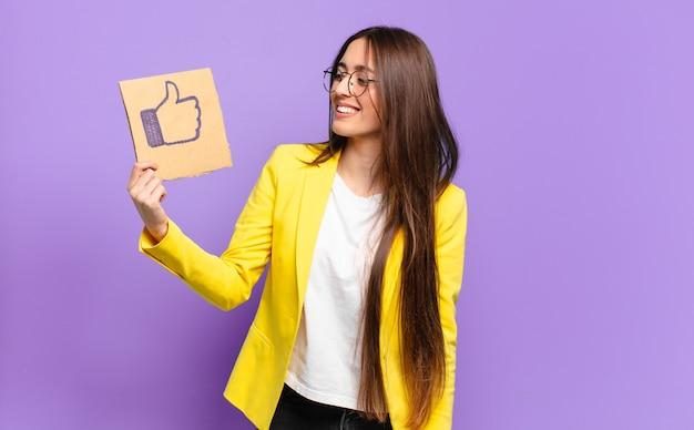 Tty businesswoman holding a social media like symbol