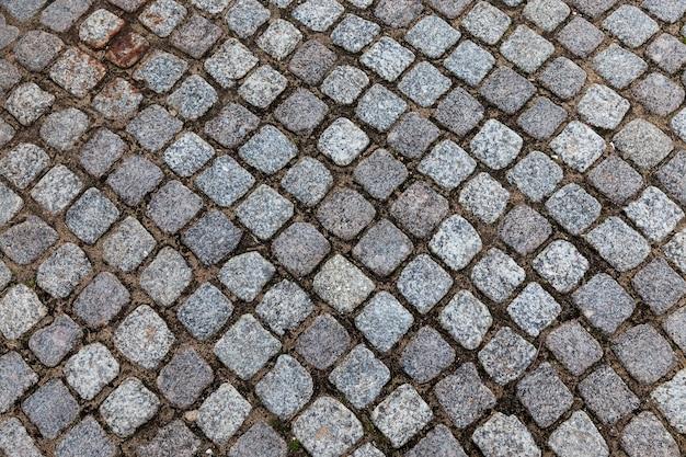 Tuile d'asphalte de forme carrée grise. photographié de près.