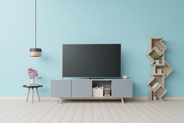 Tv dans le mur bleu de la salle vide moderne.