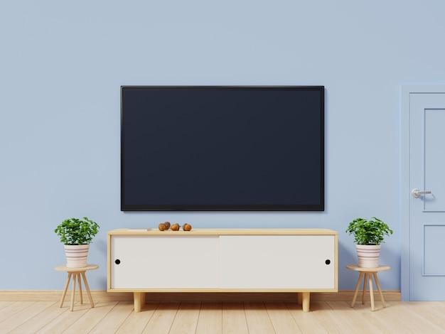Tv dans la salle vide moderne ont arrière fond de mur bleu, rendu 3d