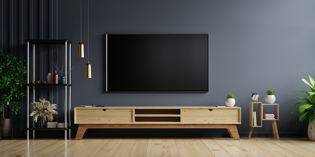 Tv led sur le mur sombre dans le salon avec armoire en bois, design minimaliste
