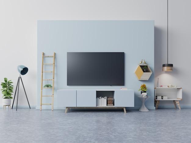 Tv sur le meuble dans le salon moderne ont des plantes et livre sur le bleu