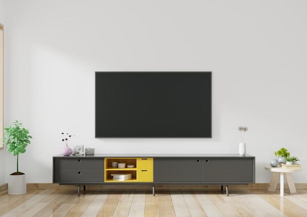 Tv sur meuble dans un salon moderne avec des plantes dans le salon avec mur blanc vide.