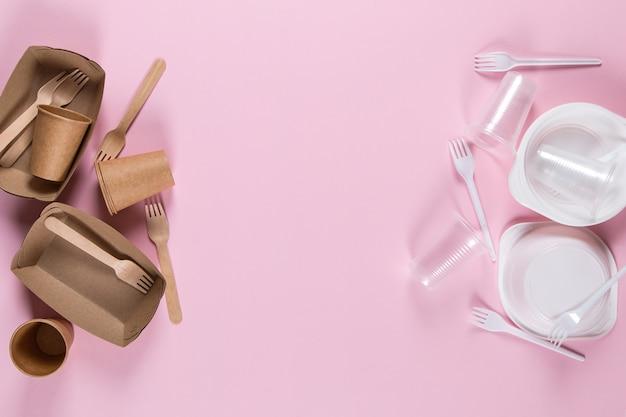 Ustensiles en plastique et papier sur rose choisir des ustensiles écologiques