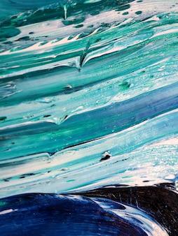 Vagues de l'océan .motion peignant la texture colorée. éclaboussures artistiques couleurs abstraites fond