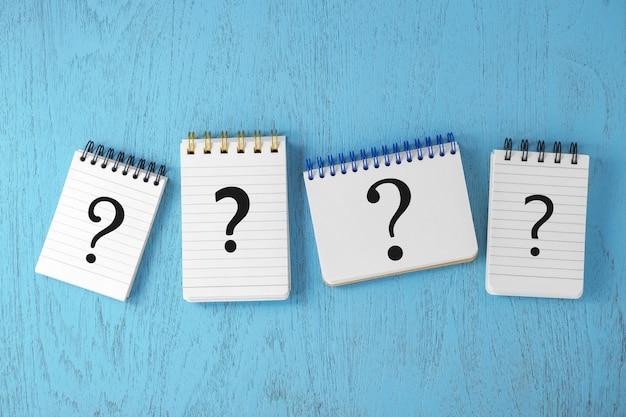 Variété de points d'interrogation sur les blocs-notes