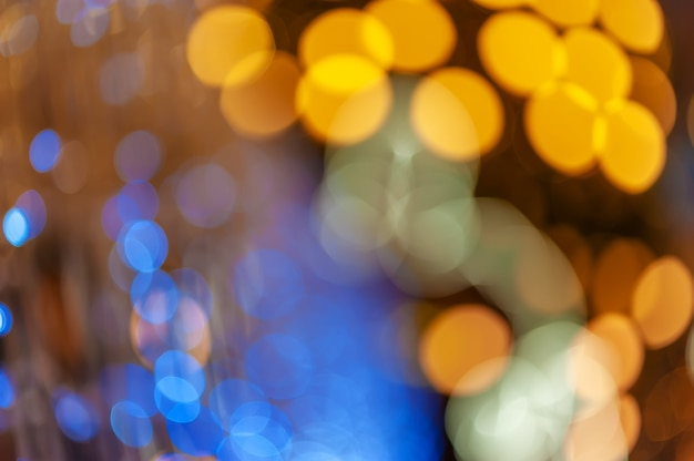 Veilleuse à la ville colorée bokeh abstrait arrière-plan flou lens flare reflet belles paillettes