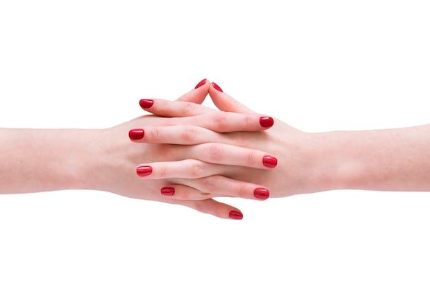 Vernis à ongles rouge mains de femmes