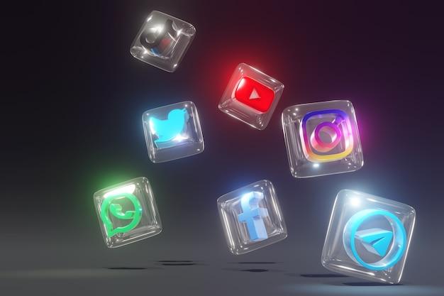 Verre 3d et logos de médias sociaux brillants avec fond sombre et position désordonnée