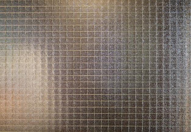 Verre abstraite avec texture de grille métallique.