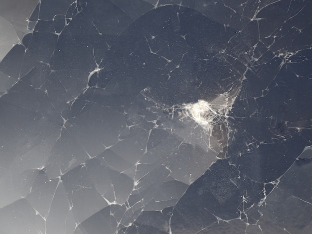 Verre fissuré de fond d'écran d'affichage à cristaux liquides cassé
