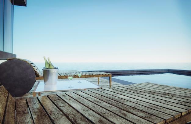 Des verres à vin et des bouteilles de vin sont placés sur la table avec des sièges. vue mer côté piscine