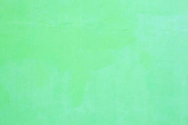 Vert clair peint couleur plaine sans soudure texturé plâtré mur rugueux fond