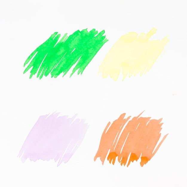 Vert; jaune; coup de pinceau rose et orange sur fond blanc