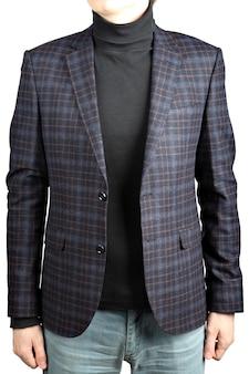 Veste de costume en laine dans la cellule en combinaison avec un jean, image isolée sur fond blanc.