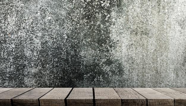 Vide étagère en bois sur le mur de ciment gris pour la présentation du produit