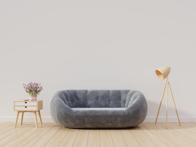Vide salon avec mur blanc ont un canapé et une armoire, lampe sur fond en bois